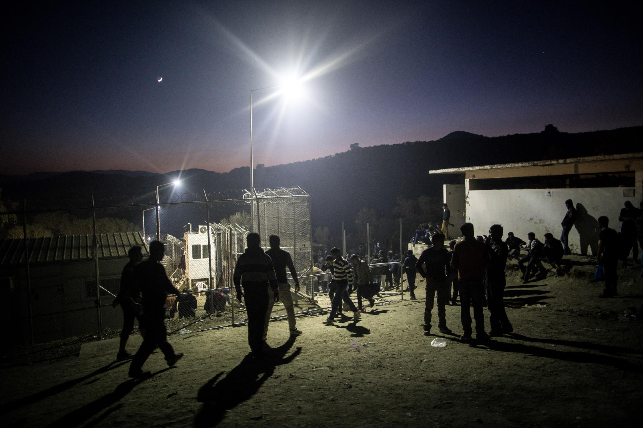 Migrants from Pakistan and Afghanistan waiting outside of the registration camp in Moria, Lesbos on October 14, 2015.