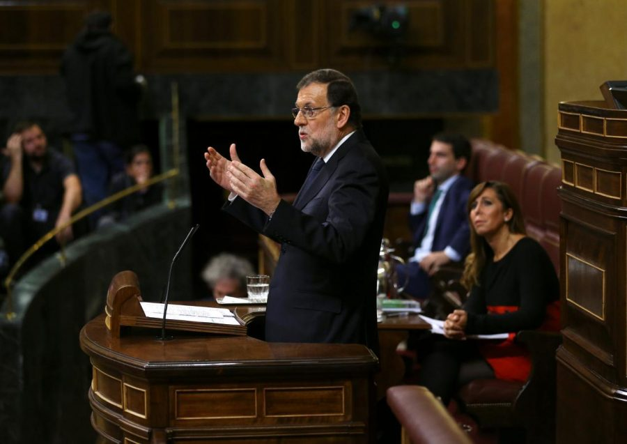 Spain's acting PM Rajoy delivers a speech during the investiture debate at the Parliament in Madrid