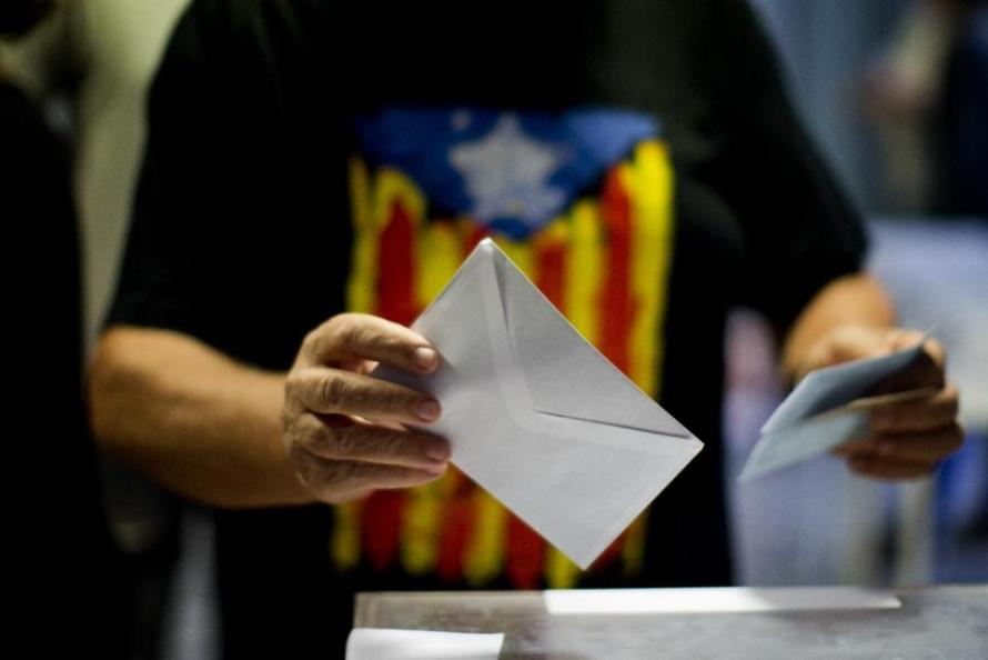 A man votes at a polling station in Barcelona, Spain, Sunday Sept. 27, 2015. Voters in Catalonia go to the polls on Sunday to elect regional lawmakers, with pro-secession parties saying they will push for independence within 18 months if they win a majority in the 165-seat parliament, as most opinion polls predict they will. (AP Photo/Emilio Morenatti)