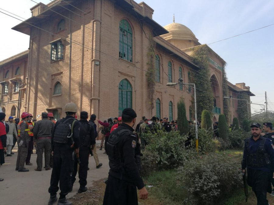 Police and rescue workers stand outside the Directorate of Agriculture Institute in Peshawar