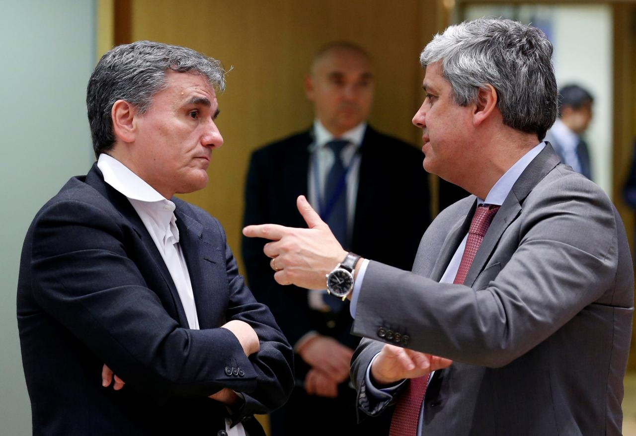 Greek Finance Minister Tsakalotos and Eurogroup President Centeno attend a eurozone finance ministers meeting in Brussels