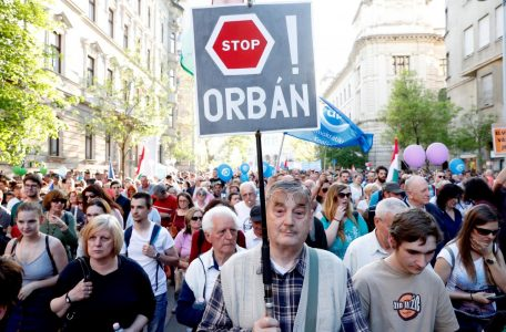 People attend a protest against the government of PM Orban in Budapest